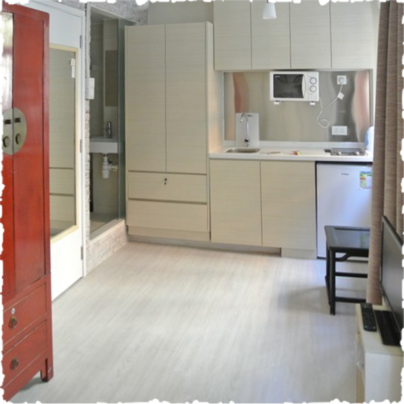 serviced apartment in Sheung Wan open kitchen cupboard